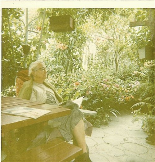 "One of my grandmother's best friends, May Lancaster, in ""The Enchanted Forest"". On any warm evening, Gram served dinner al fresco on that picnic table."