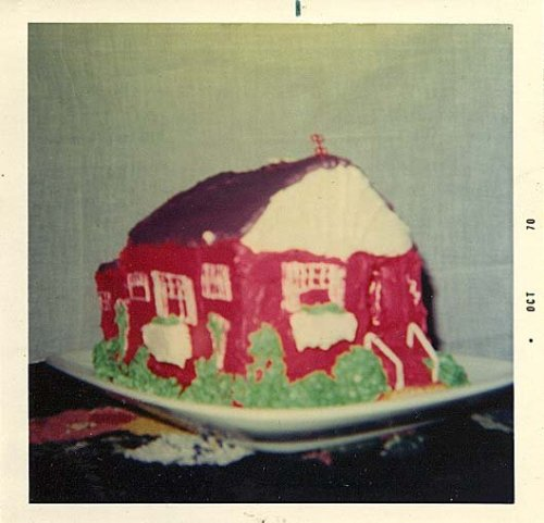 "She loved her ""little red house"" so much that she made a cake representing it..Ormy cousin George and his partner Bob may be the ones who made it."