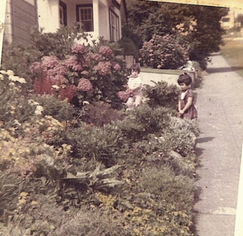 Two neighbourhood children by the front rockery. By now house 2 lots up was stuccoed.