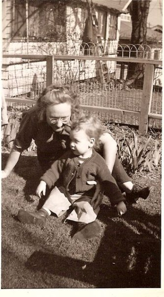 Gram and my older cousin John. This shows the back yard was once lawn.