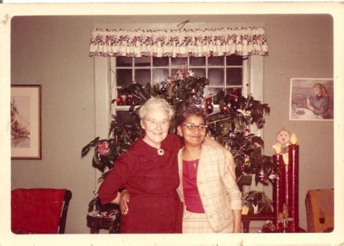 Gram and her dear friend Mary Alice in front of the hibiscus Christmas tree.