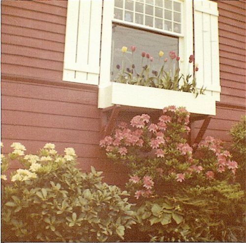 springtime.  She had added the windowboxes and shutters to the house.