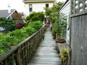 bridge from sidewalk to house