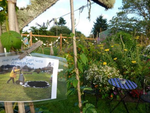 On the clothesline near the big east side flower bed, a sign showing how the garden looked in Nov. 2010.