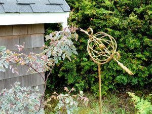 Rosa glauca and sculpture