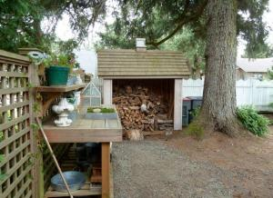 In the work area, a potting bench and woodshed