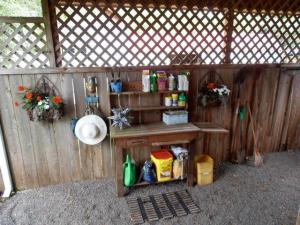 inside the open-front potting shed