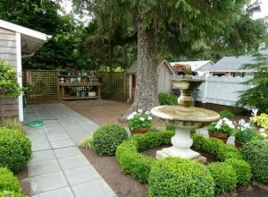 At one side of the front yard, a tidy work area