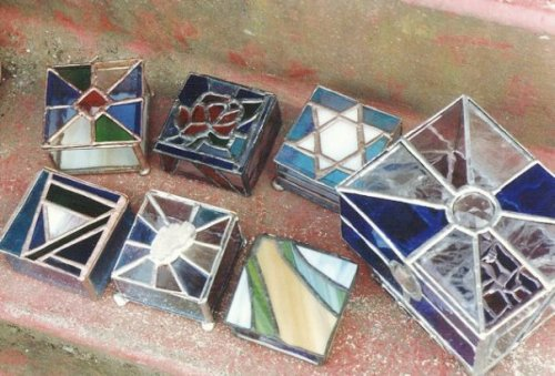 boxes, including a Star of David for Wilum, a rose, and one with crystals mounted in the lid.