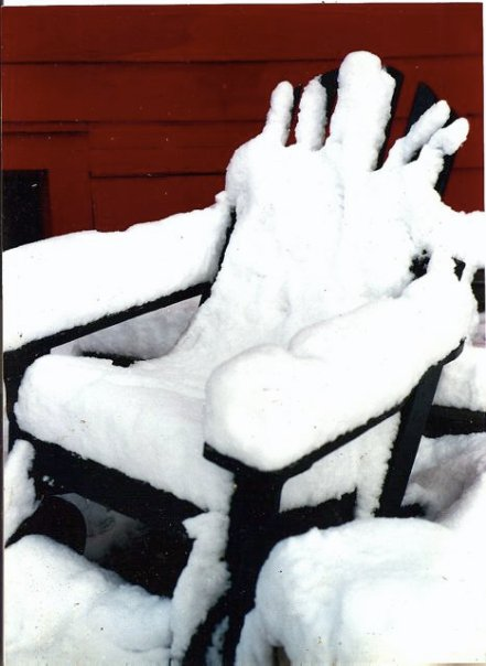 patio chair in snow
