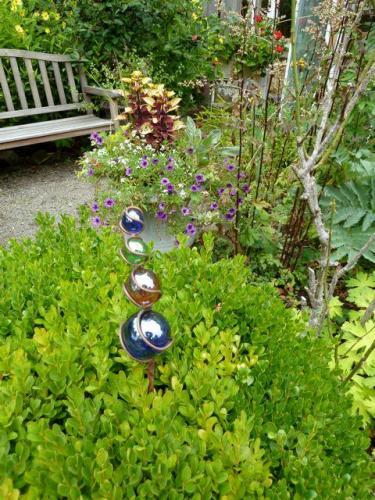 boxwood and garden art
