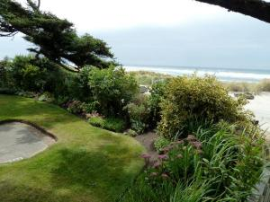 With the sandy dunes just beyond this garden, I am surprised at its lushness.