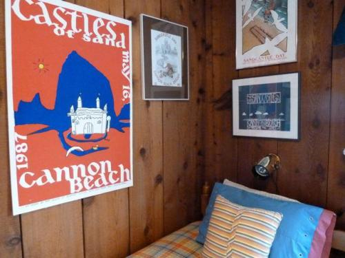 The room with two beds had a big collection of Sandcastles Day posters.