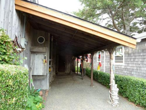 on the east side, a rustic carport