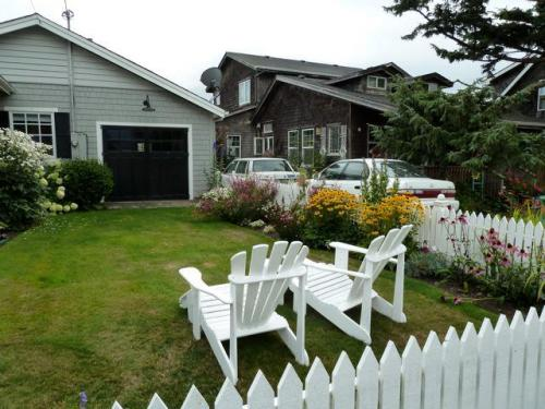 white picket fence and chairs