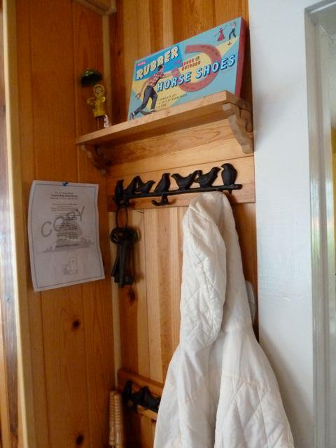 coat rack at base of stairs