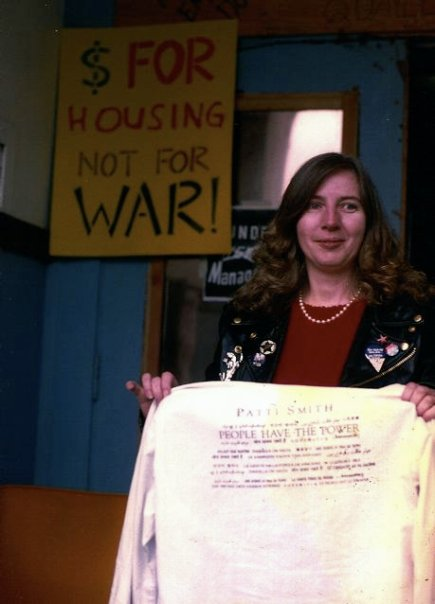 """Diane holding my shirt with the lyrics of Patti Smith's """"People Have the Power."""""""