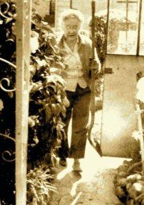 My grandmother gardening, age 75