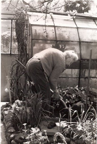My grandmother by her greenhouse, age 75