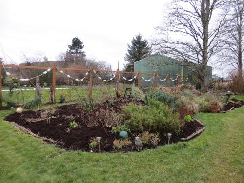 east flower bed, back garden