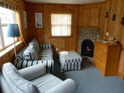 living room with river rock fireplace