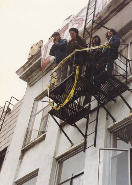 Occupiers of the building observing the arrests.