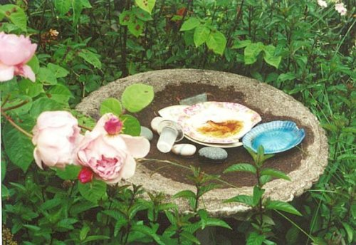 birdbath with broken china