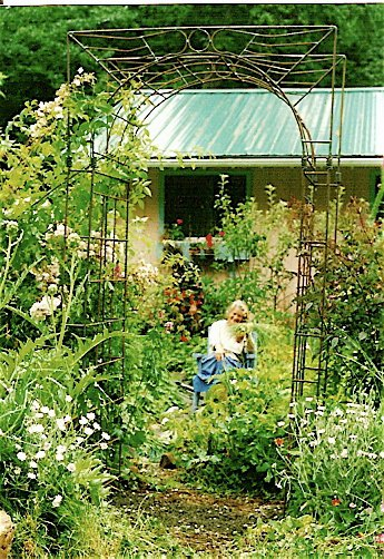 Kathleen behind the arbour she bought from Robert