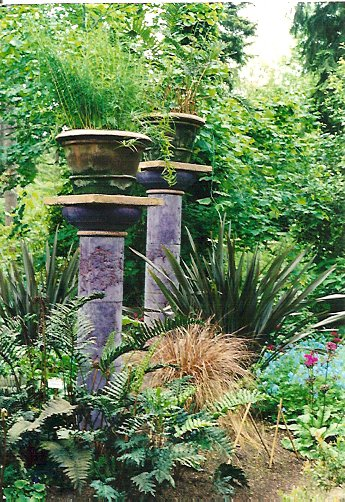 The Little and Lewis pillars in the boggy garden at Heronswood