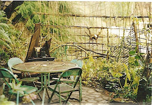 upper patio, summer 2000;  Robert made a woven fence to hide the ugly RV park view.
