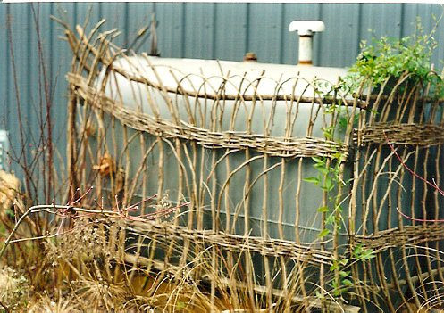 wattle fence around a tank, Ann's garden