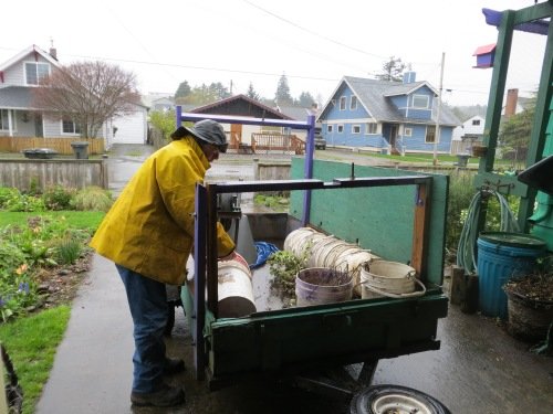Allan loading our trailer in rain.