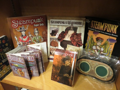 a shelf of steampunk items to go with the new Jules Verne room