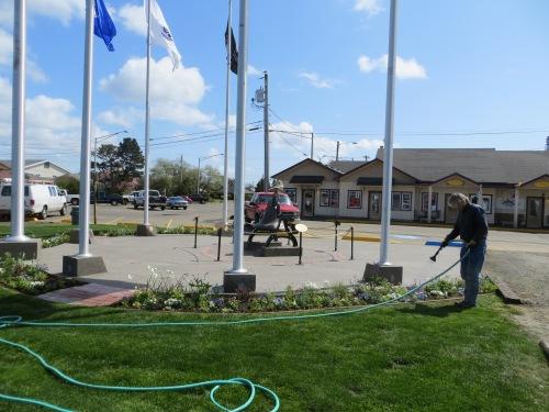 Allan hose watering the new garden