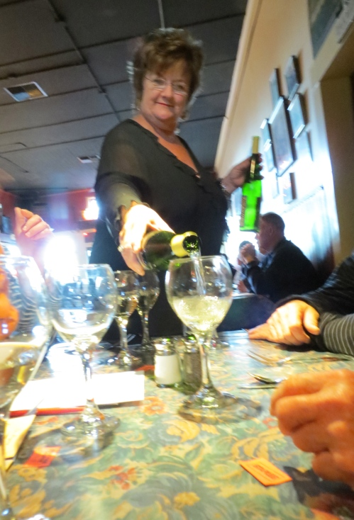 Depot owner Nancy Gorshe pours.