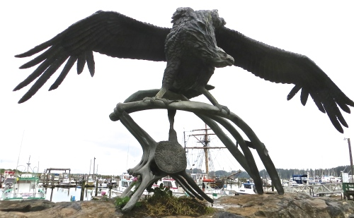 the condor statue and a tall mast