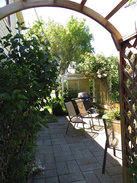 An arbour leads to another patio on the west side...
