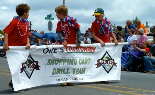 The parade always closes with the shopping cart drill team.