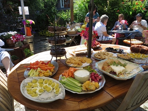a patio table laden with food
