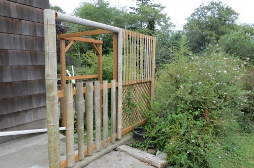 Butch's nice new entry arbour dressed up with bamboo