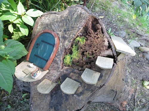 """fairy door with market basket; the fairies have gathered their """"edibles"""""""