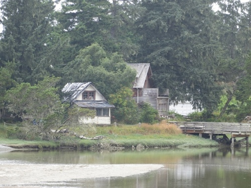 telephoto of the weathered, dreamy houses across the river