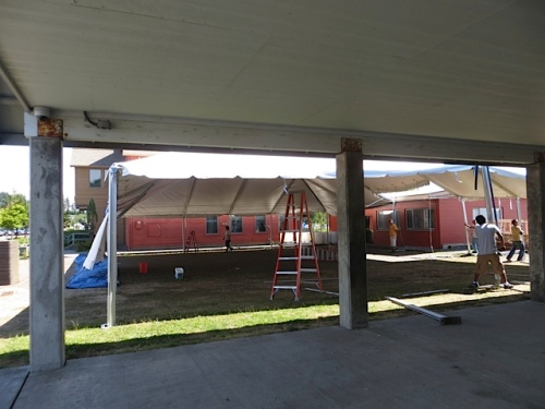 tent going up between Ilwaco pavilion and the bank building