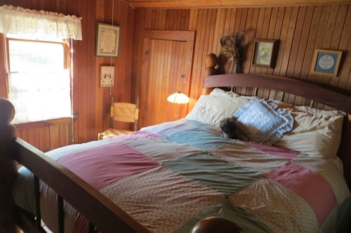 another bedroom with a tall bed