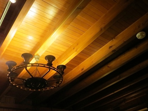 the glow of light on the beamed ceiling