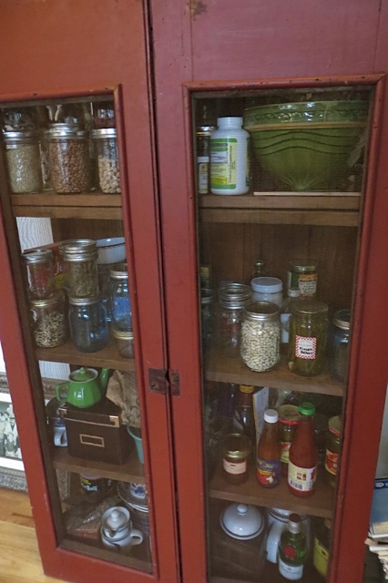a charming old kitchen cupboard