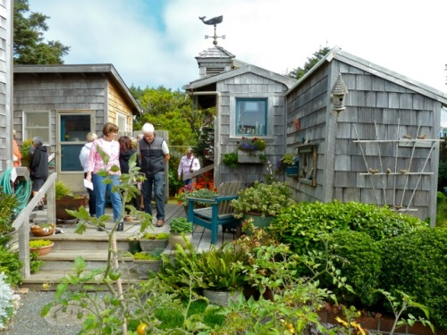 with tour guests for scale, showing the garden shed to the right