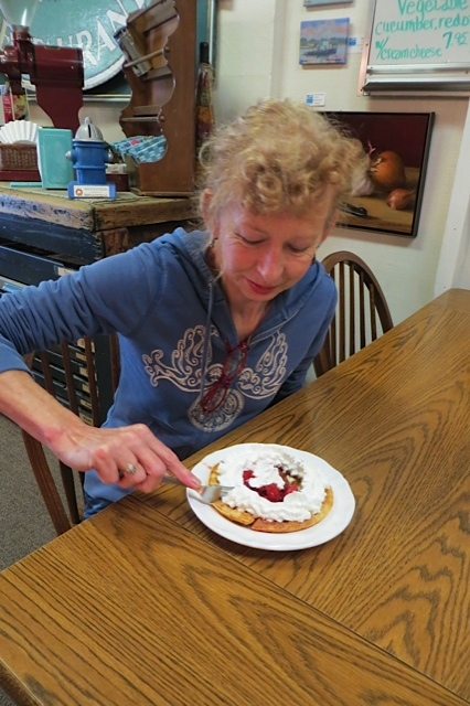 Luanne tucks into one of her signature breakfasts, waffled with strawberries and whipped cream!