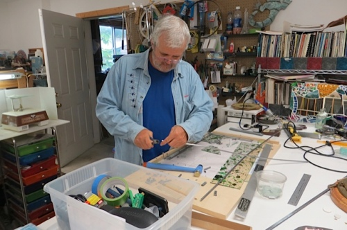 Rob making stained glass window