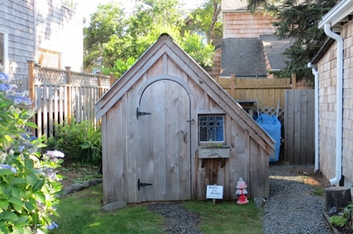 adorable storage shed on east side of house